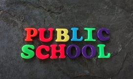 Letras de la escuela pública Fotos de archivo libres de regalías