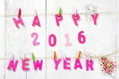 Letras de la Feliz Año Nuevo 2016 en textura de madera Fotos de archivo