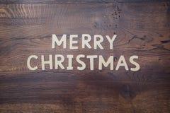 Letras de la Feliz Navidad en la madera Fotos de archivo libres de regalías