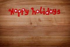 Letras de la Navidad buenas fiestas del fieltro Por los días de fiesta de la familia, Navidad o Año Nuevo, copia-espacio Fotos de archivo libres de regalías