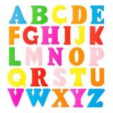 Letras de madera coloridas del alfabeto en un fondo blanco Imagen de archivo
