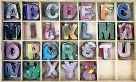 Letras de madera del ABC en una caja Foto de archivo libre de regalías