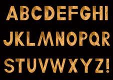 Letras de oro del alfabeto latino Imagenes de archivo