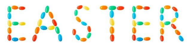 Letras de Pascua hechas de los caramelos multicolores aislados en blanco Imágenes de archivo libres de regalías
