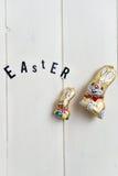 Letras de Pascua y conejitos del chocolate Imagen de archivo libre de regalías