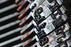 Letras de uma máquina de escrever velha Fotos de Stock