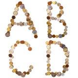 Letras del alfabeto de A-B-C-D de las monedas Imágenes de archivo libres de regalías