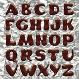 Letras del alfabeto del chocolate Fotos de archivo libres de regalías