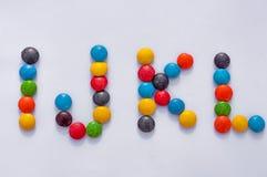 Letras del alfabeto hechas del caramelo de los colores imagenes de archivo
