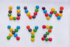 Letras del alfabeto hechas del caramelo de los colores Imágenes de archivo libres de regalías
