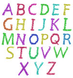 Letras del alfabeto hechas de la explosión del polvo aislada Imagen de archivo