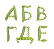 Letras del alfabeto ruso con los guisantes verdes, ABC Fotografía de archivo libre de regalías