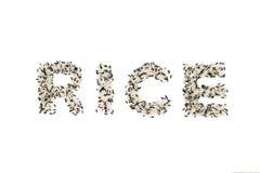 Letras del ARROZ de la mezcla de arroz negro y de arroz blanco Fotografía de archivo