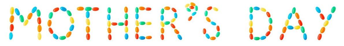 Letras del día de madre hechas de caramelos multicolores Imagen de archivo