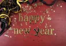 Letras del oro de la Feliz Año Nuevo Fotos de archivo