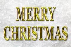 Letras del oro de la Feliz Navidad en nieve Imagen de archivo libre de regalías