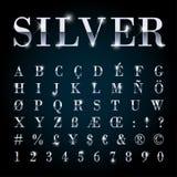 Letras determinadas de la fuente del metal plateado, números, símbolos de moneda Fotos de archivo libres de regalías
