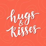 Letras dibujadas mano del cepillo de los abrazos y de los besos Fotografía de archivo libre de regalías