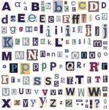 Letras do alfabeto feitas do jornal imagem de stock royalty free