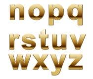 Letras douradas do alfabeto Fotografia de Stock Royalty Free