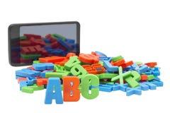 Letras e e-livro coloridos Imagens de Stock