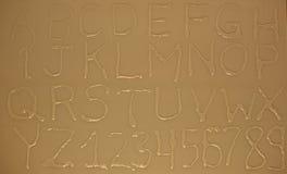 Letras e números da água Imagens de Stock