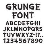 Letras e números do Grunge no fundo branco Fotografia de Stock Royalty Free
