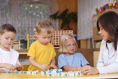 Letras e preschoolers Imagens de Stock