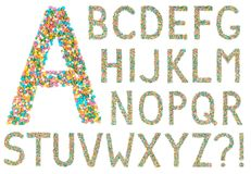 Letras e símbolos do alfabeto inglês feitos de doces pequenos Foto de Stock