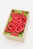 Letras en una caja Imagen de archivo libre de regalías