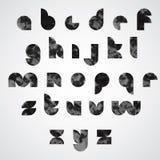 Letras minúsculas gráficas manchadas negras, fuente decorativa Imagen de archivo