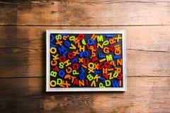 Letras plásticas coloridas Foto de Stock Royalty Free