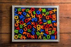 Letras plásticas coloridas Foto de Stock