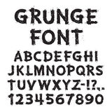 Letras y números del Grunge en el fondo blanco Fotografía de archivo libre de regalías