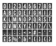Letras y números del tablero de la salida Fotos de archivo