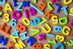Letras y números en colores Foto de archivo libre de regalías