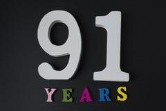 Letras y números noventa y uno años en fondo negro Imágenes de archivo libres de regalías