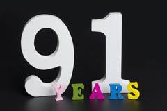 Letras y números noventa y uno años en fondo negro Imagenes de archivo