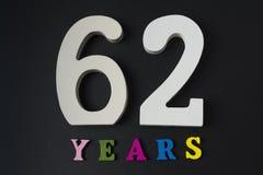 Letras y números-sesenta-dos en un fondo negro Imagen de archivo libre de regalías