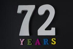 Letras y números-setenta-dos en un fondo negro Imagenes de archivo