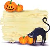 Letrero de Halloween con el gato negro y las calabazas Fotos de archivo