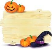 Letrero de Halloween con las calabazas y el sombrero de la bruja Imágenes de archivo libres de regalías