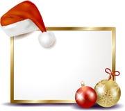 Letrero de la Navidad con el sombrero de la Navidad Foto de archivo libre de regalías