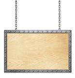 Letrero o marco de madera en la cadena aislada en blanco imagen de archivo