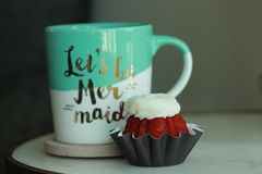 Lets be mermaids. Morning cup with coffee and sweet Red Velvet Cake Stock Photos