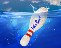 Lets Bowl. Lets bowl bowling pin splashing in blue ocean water stock image