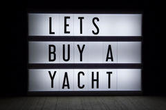 Lets buy a yacht Stock Photos