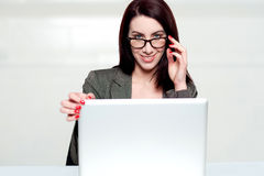 Lets call it a day. Woman shutting down laptop. And holding glasses looking at you stock photos