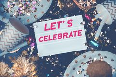 Lets celebrate on light box with party cup,party blower,tinsel,c stock images