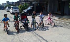 Lets che gioca bicicletta Fotografia Stock